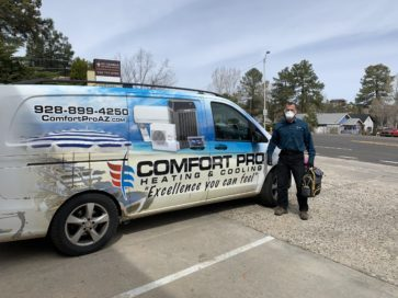 Comfort Pro Technician in-front of Comfort Pro van with face mask from Confort Ptro Heatign and Cooling Prescott AZ