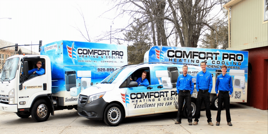 comfort pro heating and cooling team with trucks